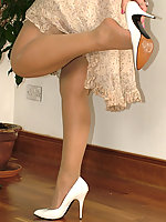 Brunette in sheer grey stockings & cream stilettos