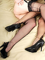 The girls get all their sexy lingerie nylons and heels on ready for a night on the town, but when they see how horny they both look decide on a hot night in.