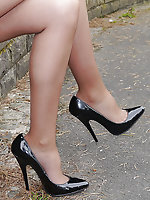 Cute Claire is outdoors in tall black high heel shoes and sexy nylons showing off her lovely long legs