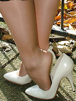 Cute blonde Iona is teasing in a very sexy pair of white stilettos