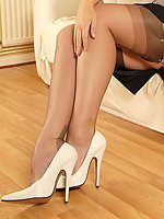 Shay is simply perfection in tight white girdle, coffee ff nylons and those wicked white spike heels.